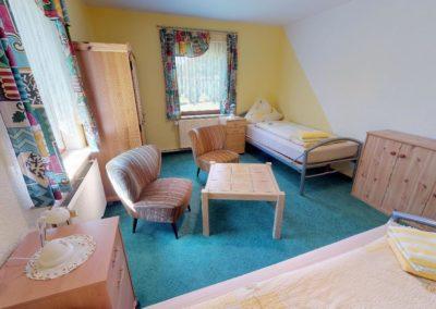 Schlafzimmer mit zwei Einzelbetten der Ferienwohnung Ganderkesee